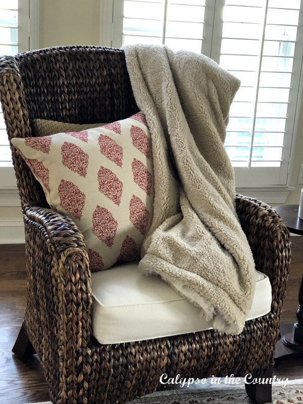 cozy sherpa blanket on seagrass chair
