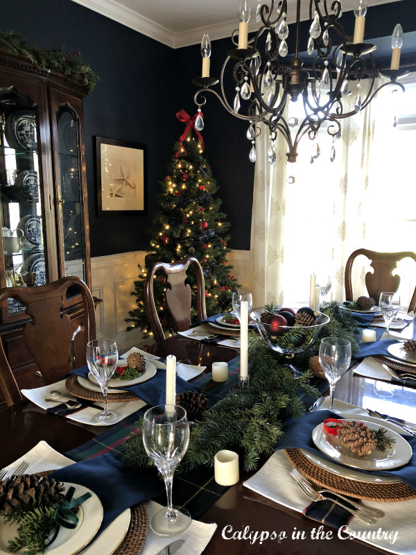 Dining room table with Christmas tree in background
