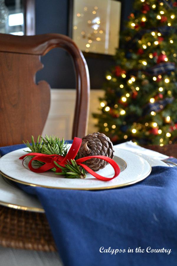 Navy napkin on Christmas table with Christmas tree