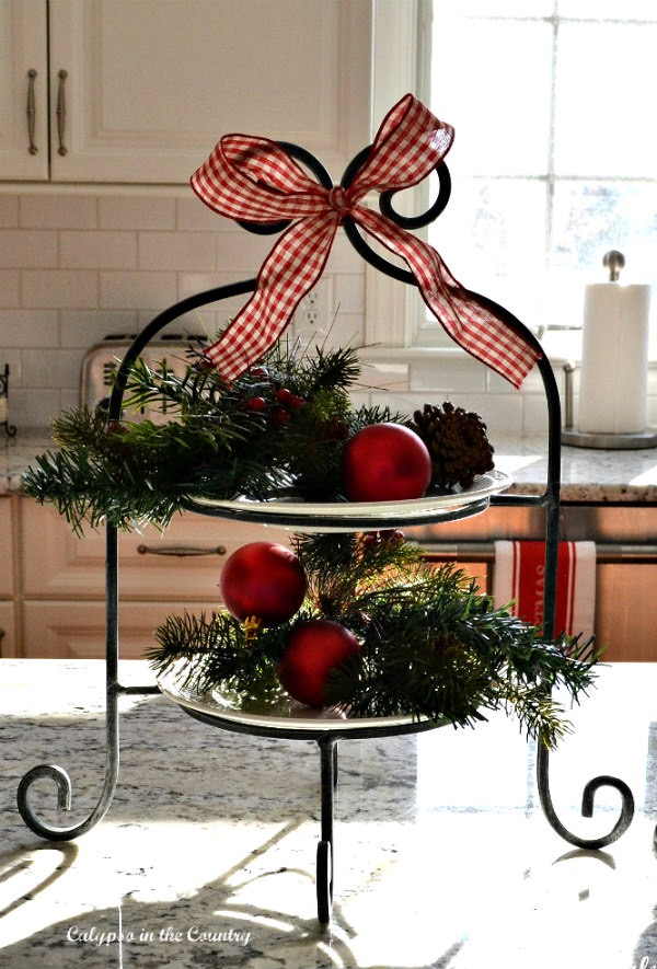 Red ornaments on tiered tray