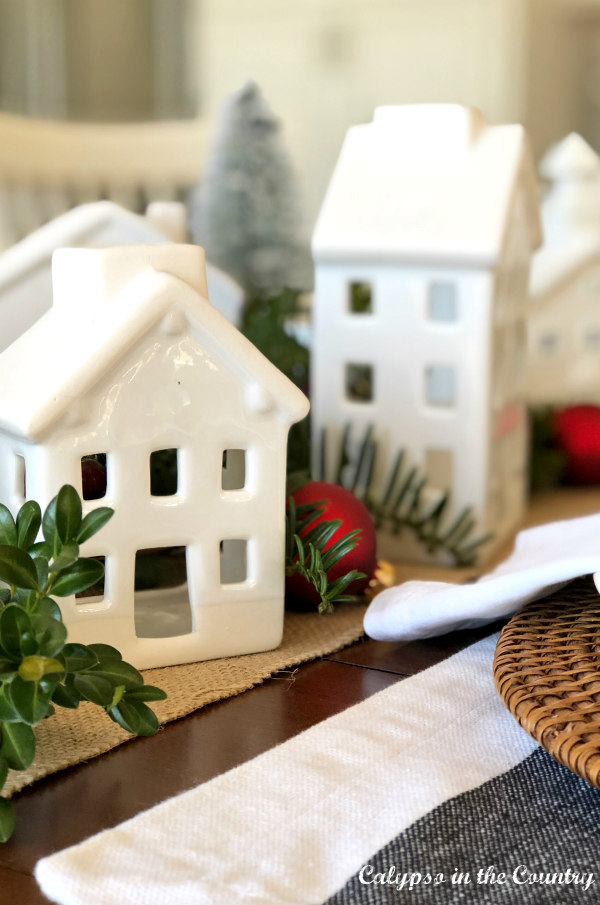 White ceramic houses with red Christmas ornaments