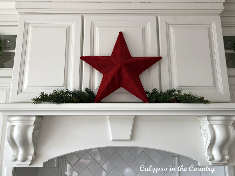 Red star on white stove mantel for Christmas