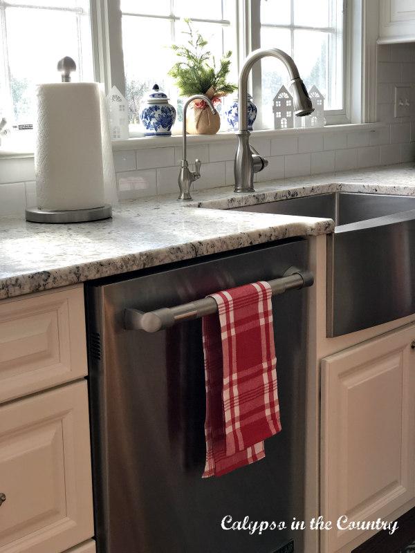 Red towel hanging on dishwasher