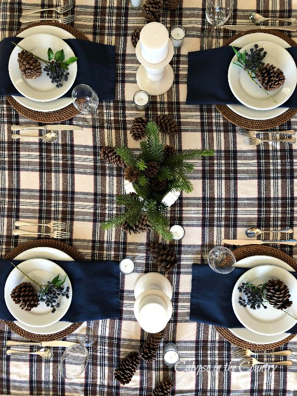 Navy and brown plaid tablecloth with four place settings