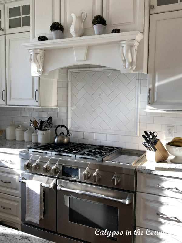White kitchen decorated for winter
