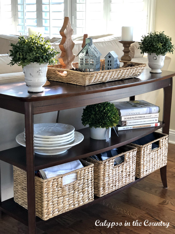 winter whites and neutral accessories on wood console table