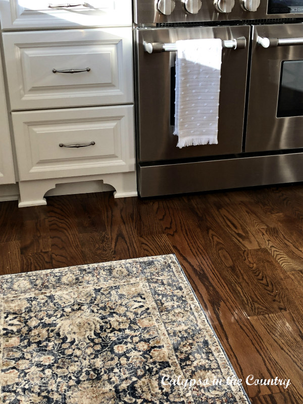 White kitchen with rug by stove