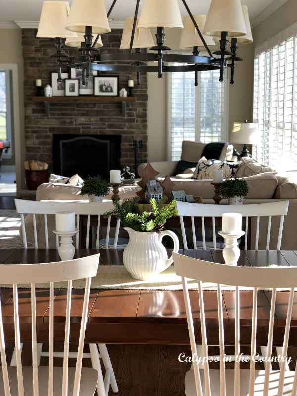 White farmhouse style chairs with winter white centerpiece on table