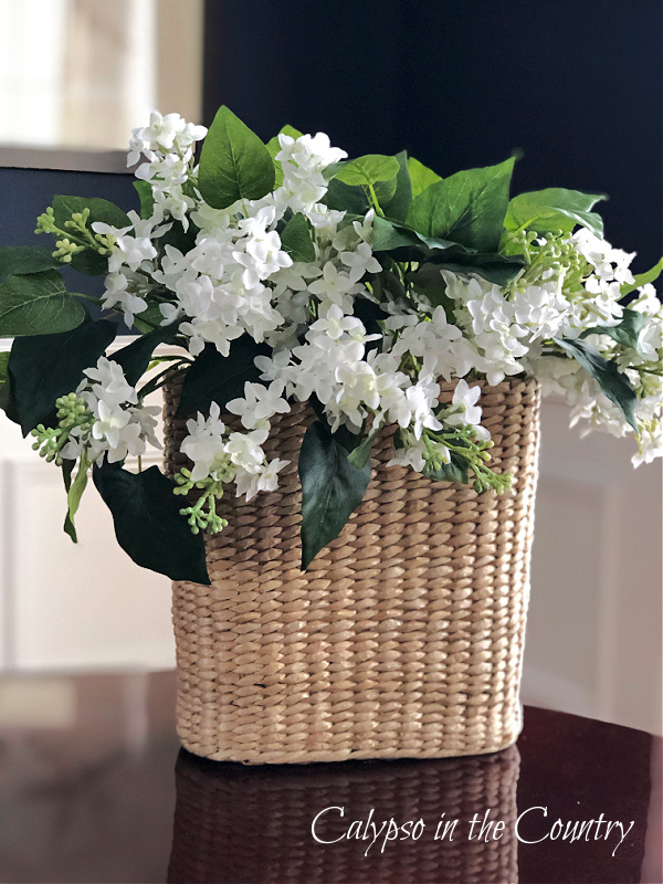White flowers in seagrass basket