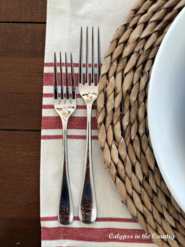 Natural woven charger on red and white striped placemat - Saturday Spotlight feature