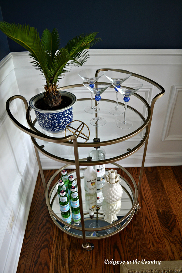 round gold bar cart with blue and white for spring