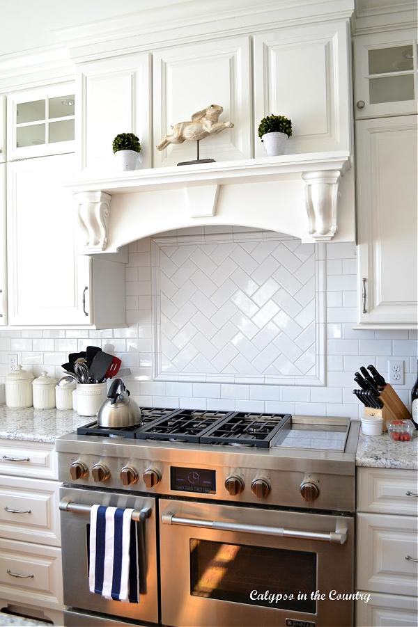 Bunny on stand displayed on stove mantel