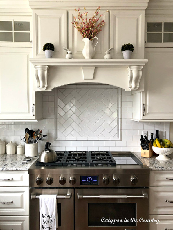 Flowers and bunnies on stove mantel - simple Easter decor