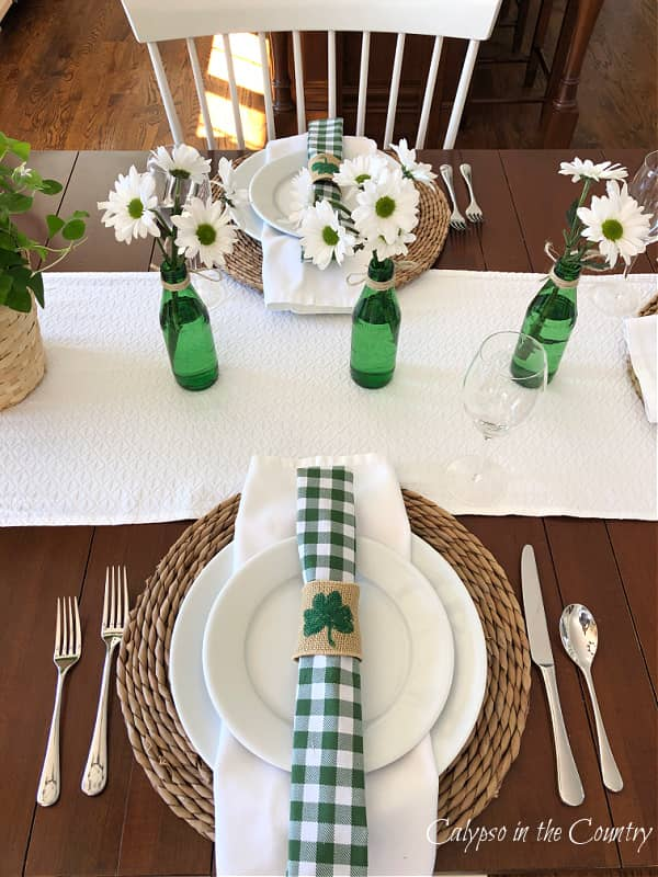 Green and white place settings for St. Patrick's Day