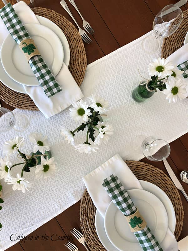 Top view of table with green and white St. Patrick's Day table decor