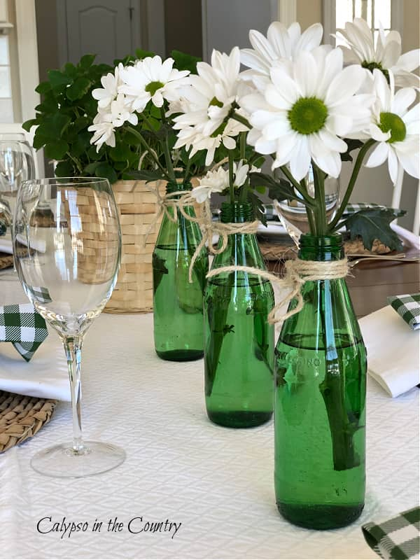 Green bottles and daisies for St. Patrick's Day table decor