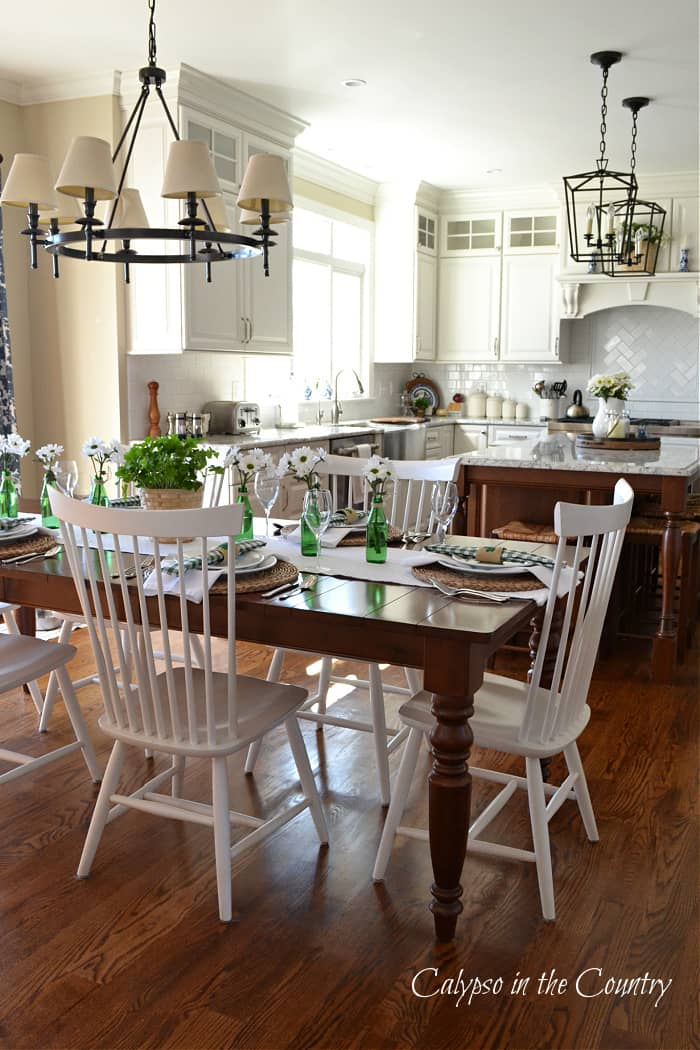 Wood table with White chairs in white kitchen - St. Patrick's Day table decor