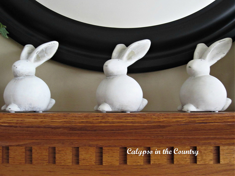 White ceramic bunnies on mantel