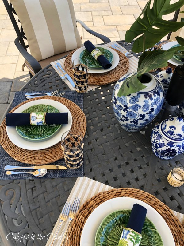 Blue, white and green table setting on patio for Mother's Day