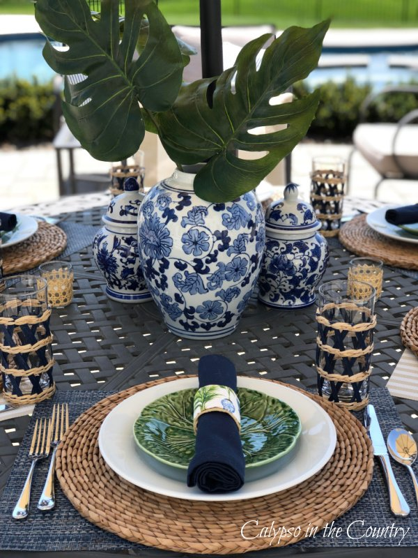 Blue and white porcelain and tropical accessories on patio table - ideas for Mother's Day table deco