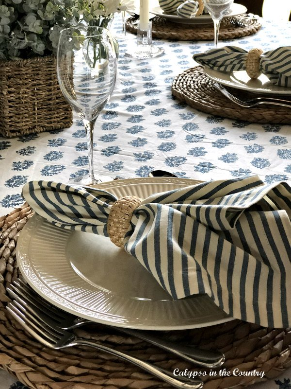 Blue and white place setting on block print tablecloth - Mother's Day decor