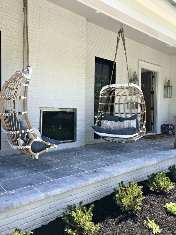 Hanging porch swings and outdoor fireplace - outdoor living space ideas