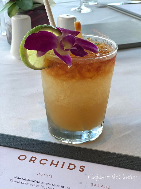 orchid garnishing tropical drink