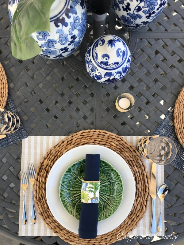 blue and white tropical table setting on patio
