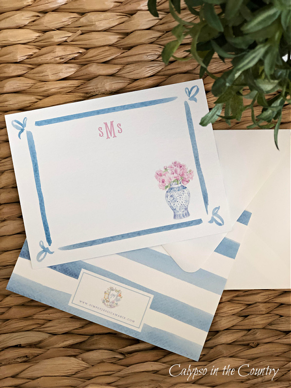 Blue and white monogrammed notecards on seagrass tray