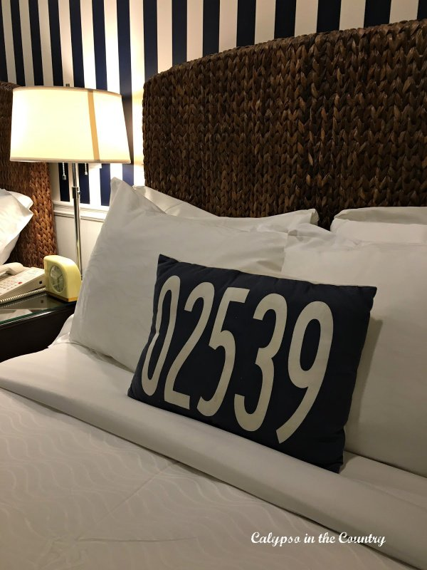hotel bed and navy and white striped wallpaper - decorating with stripes