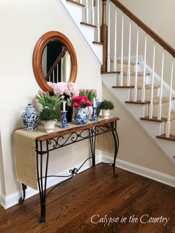 Foyer table with mirror - how to decorate an entry table for spring
