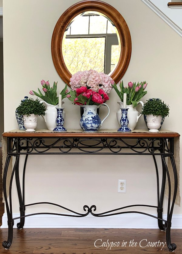 Foyer table with flowers and blue and white porcelain - how to decorate an entry table for spring