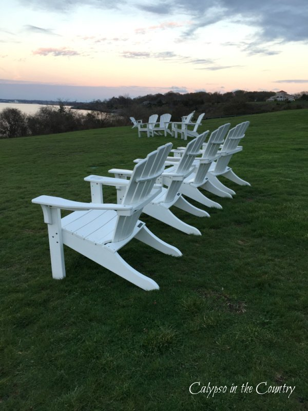 White Adirondack Chairs at sunset - best summer road trips