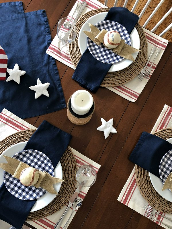 patriotic tablescape with baseballs and red and white striped placemats - decorating with stripes