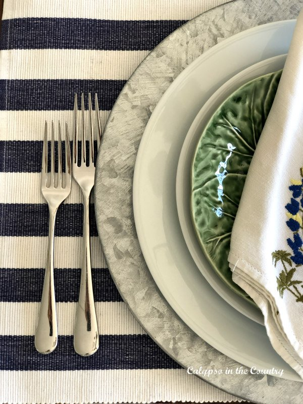 Place setting with navy and white striped placemat