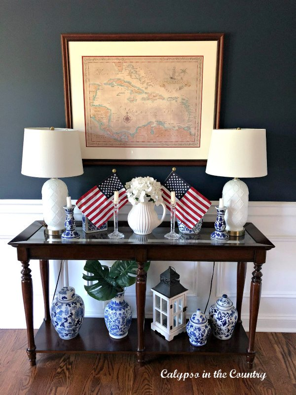 console table with flags and white lamps - patriotic home decor ideas