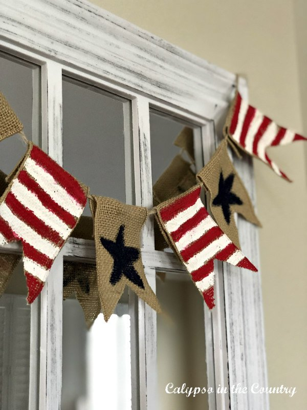 Patriotic banner hanging over mirror - pretty diy summer decor ideas