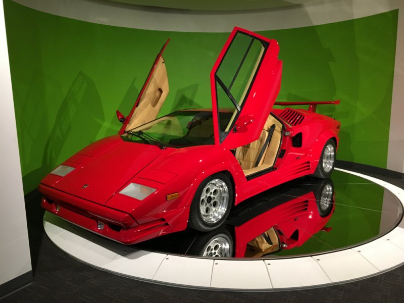 Red Ferrari at car museum - ideas to celebrate father's day
