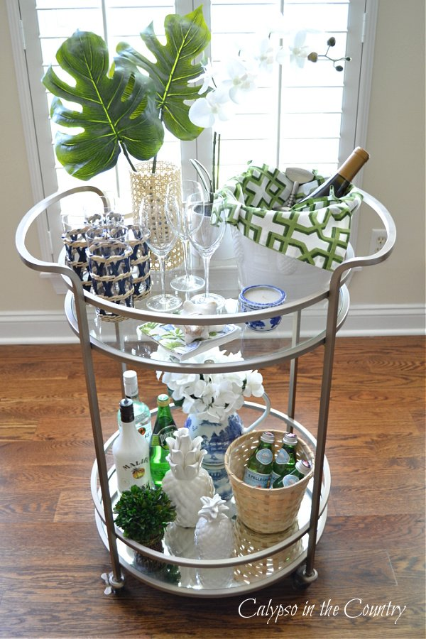 Round gold bar cart and refreshing summer beverages