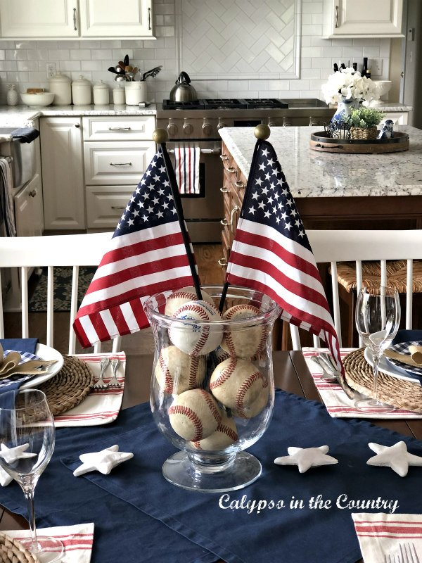 flags and baseballs in glass hurricane for 4th of July - patriotic home decor ideas