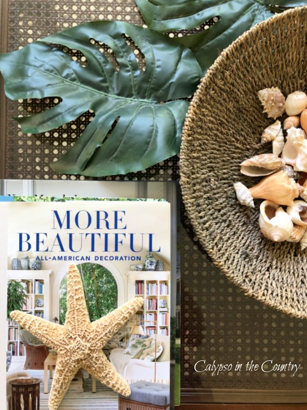 bowl of shells and coffee table books - tropical styling ideas