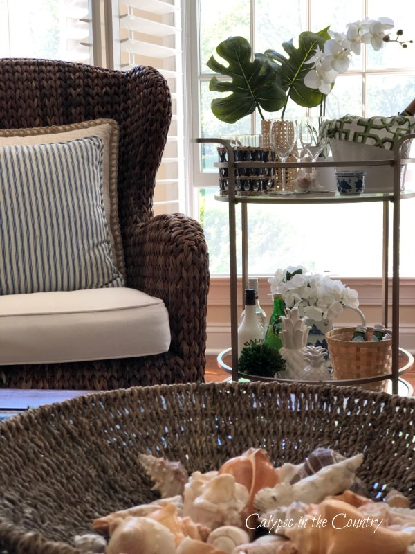 basket of shells and tropical bar cart styling tips