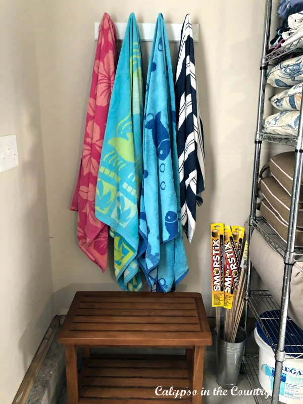 hanging pool towels and garage storage tips - summer home improvement ideas