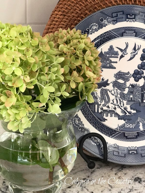 Hydrangeas with blue and white plate - early fall decor ideas for the kitchen