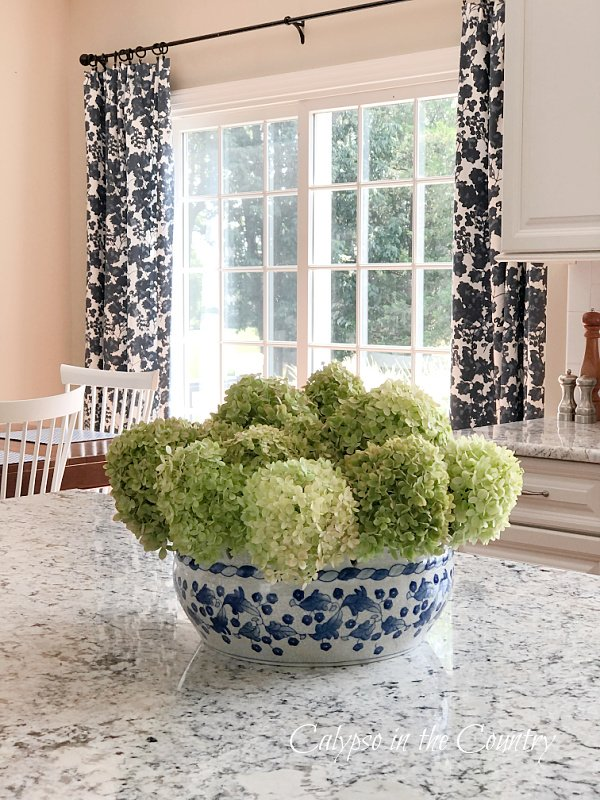 Hydrangeas on island with blue and white - early fall decor ideas