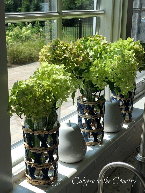 green hydrangeas on windowsill - early fall decor ideas