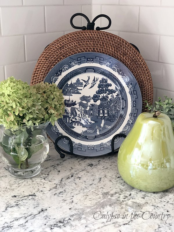 Blue and white plate with hydrangeas and green pear - early fall decor ideas
