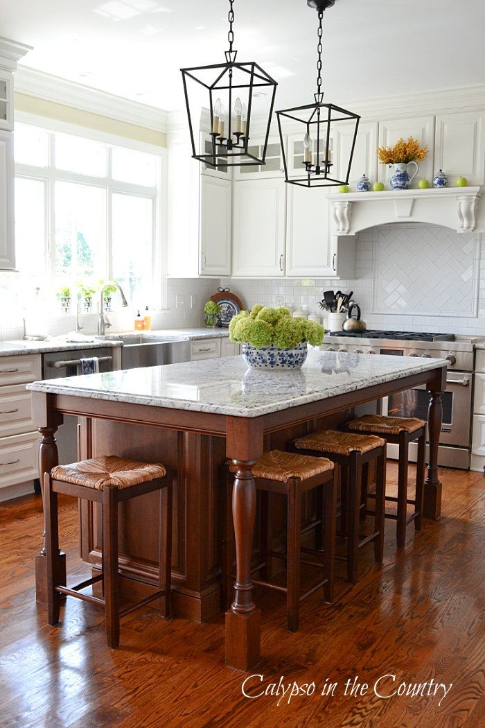 white kitchen decorated for early fall