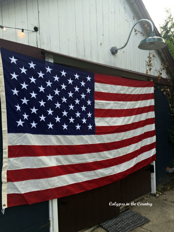 American Flag hung on barn in honor of National Americana month