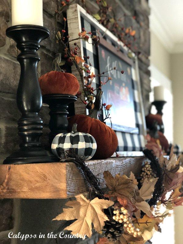 buffalo check pumpkin on fireplace mantel